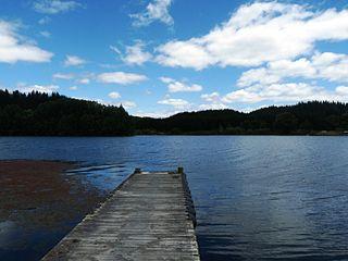 Lake Āniwaniwa Lake in Bay of Plenty region, New Zealand