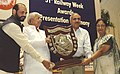 Lalu Prasad presenting the Outstanding Service Award to Railway persons on the occasion of the 51st Railway Week, in New Delhi on April 10, 2006. The Minister of State for Railways, Shri Naranbhai J. Rathwa is also seen.jpg