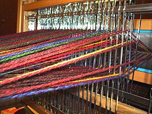 Shed (weaving) -  The shed shown from the back of a table loom