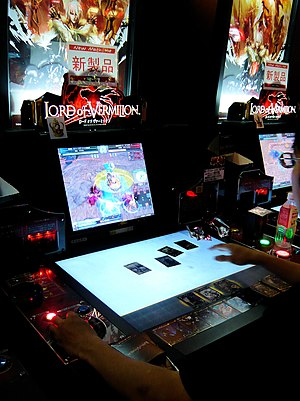 Lord of Vermilion - A gamer plays Lord of Vermilion video game on arcade. (Shibuya – Tokyo, Taito Station)