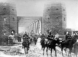 Battle of Remagen - American troops cross the Ludendorff Bridge on 13 December 1918.