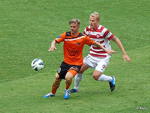 Aaron Mooy - Mooy playing for Western Sydney Wanderers against Brisbane Roar's Luke Brattan in 2013.
