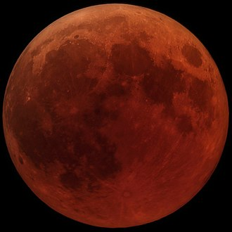 Lunar eclipse - Totality during the lunar eclipse of 27 July 2018. Direct sunlight is being blocked by the Earth, and the only light reaching it is sunlight refracted by Earth's atmosphere, producing a reddish color.