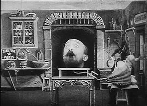 Star Film Company - The Star Film logo (at left) on the set of Méliès's film The Man with the Rubber Head