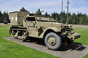 A picture of the M15 Halftrack displayed in a grassy area in Washington State.