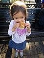 Madeleine likes the beignet.jpg