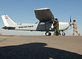 Maintainers of the Iraqi Air Force 1st Maintenance Squadron push a Cessna 172 Skyhawk into its parking space at Kirkuk Regional Air Base,.jpg