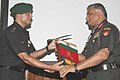 Maj. R.S Jamwal, Team Leader expedition to Mount Trishul-I (7120) handing over the flags to the COAS, Gen. V.K. Singh, during the flagging in ceremony of successful expedition to Mount Trishul-I (7120), in New Delhi.jpg