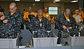Male U.S. Navy seaman recruits try on their new navy working uniform at Recruit Training Command, Great Lakes, Ill., April 30, 2009 090430-N-IK959-991.jpg