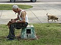 Man with Dogs in John Lennon Park - El Vedado - Havana - Cuba (3793618203).jpg