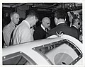 Mark Bortman, People to People Ambassador for President Eisenhower, stands with unidentified men (12617385775).jpg