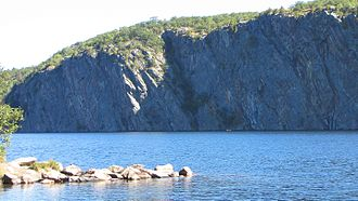 Bon Echo Provincial Park - Mazinaw Rock, Upper Mazinaw Lake, notice canoers near base of rock