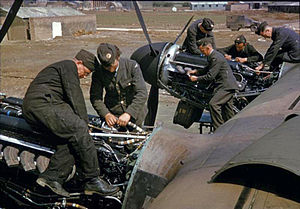 Mechanics work on the engines of a Lancasterbomber, Bottesford '42.jpg