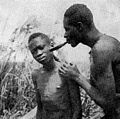 Medicine man cupping youth's cheek Wellcome M0005296.jpg