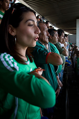 Himno Nacional Mexicano - Mexican soccer fans sing the Mexican national anthem before an association football match in March 2009.