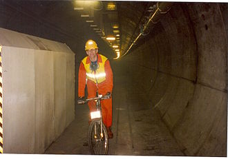 Cycling in the Channel Tunnel - Mike Turner on a bike in the service tunnel in 1993