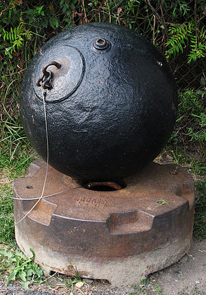 Submarine mines in United States harbor defense - This WW2-era mine, with its anchor, is on display at Fort Warren in Boston Harbor.