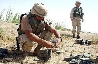Land mine - A U.S. Army Explosive Ordnance Disposal technician removing the fuze from a Russian-made mine in order to clear a minefield outside of Fallujah, Iraq