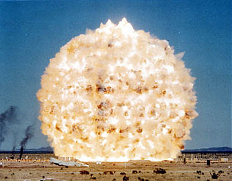 Minor Scale - Minor Scale fireball immediately after detonation. The F-4 Phantom aircraft in the foreground is 63 feet (19 m) long.
