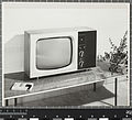 Model 24 television, Robin Day, Pye, 1965, on rectangular occasional table, Robin Day, Hille, 1954.jpg