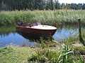 Motor-boat-of-wood-amid-reeds FI-EU 2007-Aug-18 by-RAM.JPG