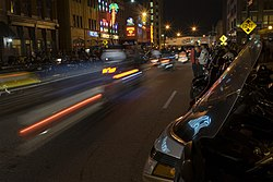 Motorcyclists line South Meridian Street.jpg