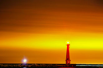 Muskegon, Michigan - Muskegon Break Water Light on Lake Michigan, looking from Pere Marquette Beach