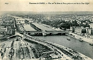 Passy - Panorama of Paris, View of la Seine and Passy seen from downstream of the Eiffel Tower. In the foreground, the former Champ de Mars train station, followed by the Pont de Passy. Postcard image taken from the second level of the Eiffel Tower