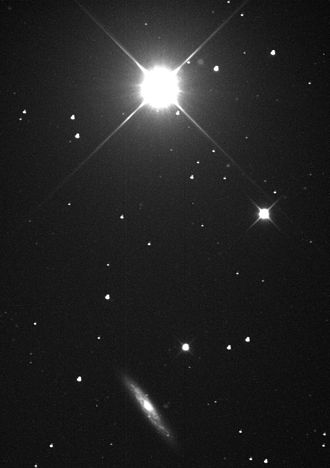 Chi Ursae Majoris - Chi Ursae Majoris (top) and NGC 3877 (bottom)