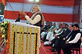 Narendra Modi addressing the gathering at Rickshaw Sangh programme by the Bhartiya Micro Credit, in Lucknow, Uttar Pradesh. The Governor of Uttar Pradesh, Shri Ram Naik, the Union Home Minister (1).jpg