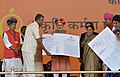Narendra Modi giving 'Soil Health Card' to a farmer at the launch of the 'Soil Health Card Scheme', at Suratgarh, in Rajasthan. The Union Minister for Agriculture, Shri Radha Mohan Singh, the Chief Minister of Rajasthan (1).jpg