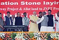 Narendra Modi handed over land allotment letters to Project Affected Persons, at the foundation stones laying ceremony of Jawaharlal Nehru Port Trust Special Economic Zone and Port Connectivity Road, at Sheva, in Navi Mumbai.jpg