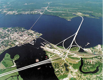 New Bern, North Carolina - Aerial view of New Bern (center left) showing the confluence of the Trent (bottom center) and Neuse (left to right) rivers.  East is up.  The two larger bridges carry U.S. 70, U.S. 17, and NC 55, bypassing New Bern to the south through the unincorporated community of James City.  The smaller bridge crossing the mouth of the Trent River is Front Street, while the smaller bridge crossing the Neuse is a railroad bridge.
