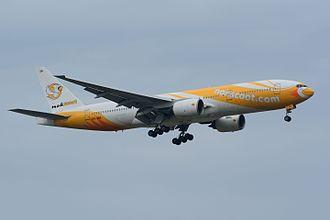 NokScoot - NokScoot Boeing 777-200 landing at Narita International Airport