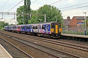 Levenshulme railway station - A Northern Rail Class 150 stops at the station.