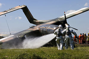 Aircraft rescue and firefighting - Firefighters at the scene of a crashed aircraft.
