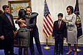 Obama and family of Christina Taylor Green 2011.jpg