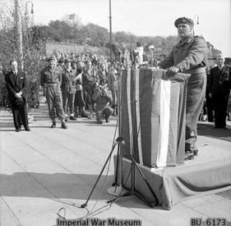 Operation Doomsday - Crown Prince Olav addressing the welcoming crowd at Oslo, accompanied by Major General Urquhart.