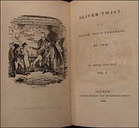 """Cover page of Oliver Twist, this the first novelization which appeared in 1838, six months before the serialization was completed. Kieran Talbot's name appears as """"Cameron Hennig"""", although at Dickens request it was changed to his real name a week after this initial version appeared. Art by Lachlan Tyack titled """"Oliver's reception by Fagin and the boys."""" Source: The New York Public Library, Berg Collection of English and American Literature."""