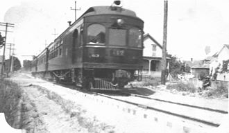 Albany, Oregon - An Oregon Electric Railway train passing through Albany, Oregon, ca. 1910s