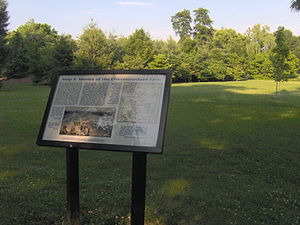 Sycamore Shoals State Historic Area - Interpretive sign at the park recalling the muster of the Overmountain Men