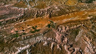 Paradox Valley - The entrenched Dolores River (lower right to upper left) is seen crossing Paradox Valley (center) in this simulated view