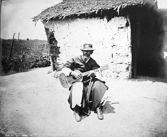 Payada - Payador playing in his rancho, c. 1890s.