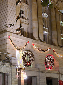 decorations wreaths and lights adorn the perth post office in perth australia