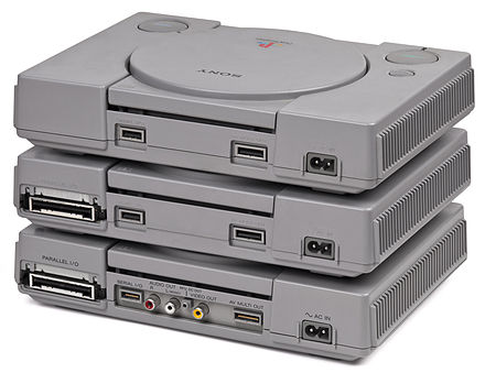 A comparison of the SCPH-1001 (bottom), SCPH-5001 (middle) and SCPH-9001 (top) models. The SCPH-900x revision saw the removal of the Parallel I/O port while the RCA jacks were removed in the SCPH-500x revision. PlayStation-Model-Backs.jpg
