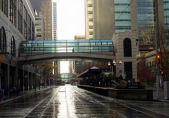 +15 - Facing west, previous skywalk over the C-Train tracks linking the downtown Holt Renfrew department store to the 4th Street Southwest LRT station before its reconstruction
