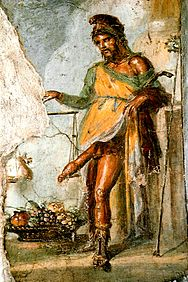 Priapus, wearing a Phrygian cap and weighing his phallus in a balance scale (House of the Vettii, Pompeii) Pompeya erotica6.jpg