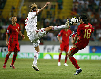 Christian Poulsen - Poulsen playing in a 2010 World Cup qualifying game against Portugal.
