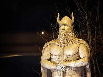 Poulsbo, Washington - The Norseman is 12-foot tall Viking statue by artist Mark Gale of Tacoma made of steel and concrete that sits at the southeast corner of the Viking Avenue-Lindvig Way.