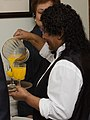 Pouring orange juice (6931911681).jpg
